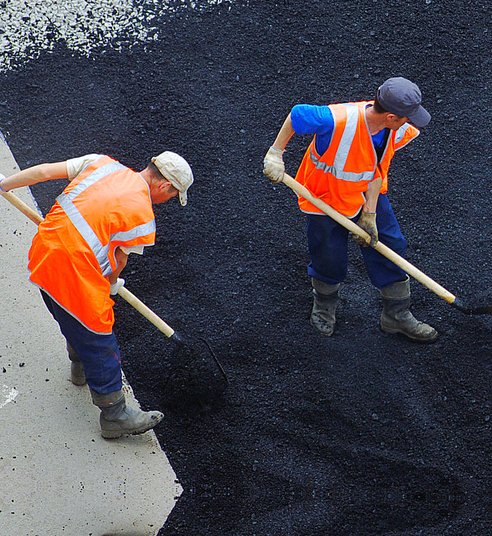 construction workers sealcoating the asphalts